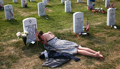 Mary McHugh visited the grave of her fiancé, Sgt. James J. Regan, who was killed in Iraq in February. He is buried in the new Section 60 of Arlington National Cemetery for those killed in Iraq and Afghanistan. John Moore/Getty Images NY Times 5/27/07 .